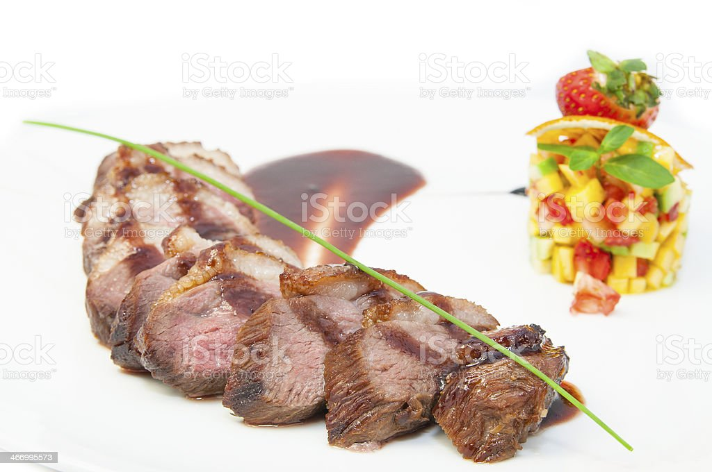 baked meat with fruit salad royalty-free stock photo