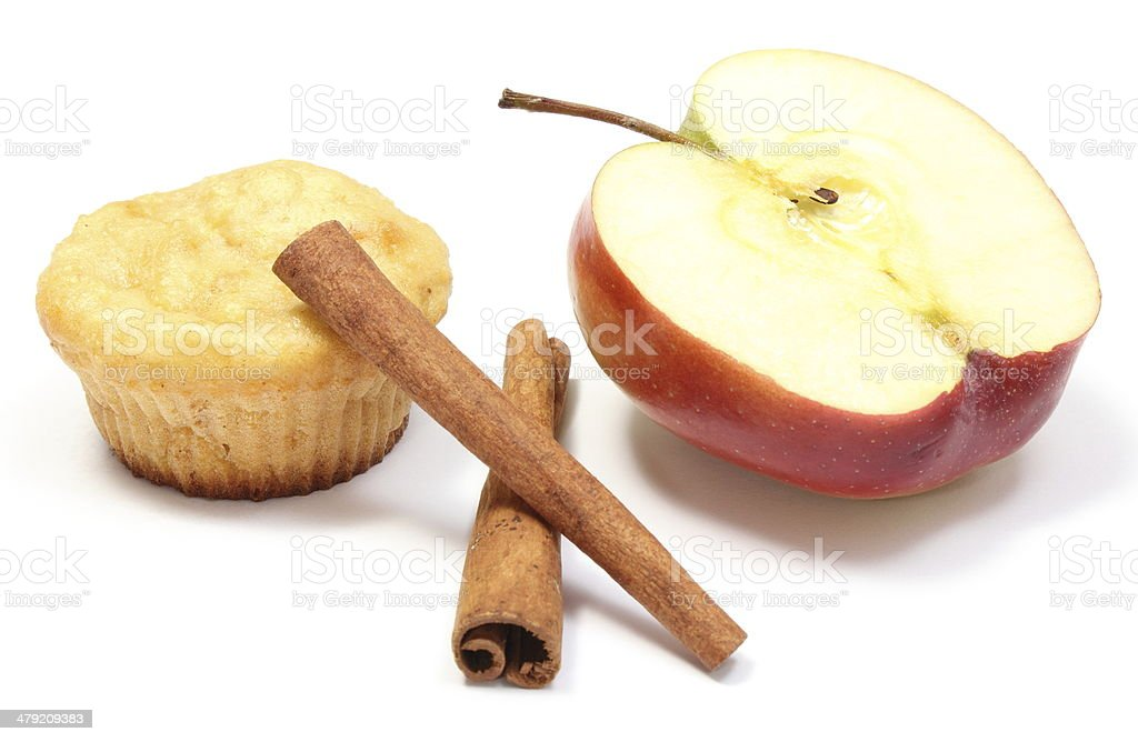 Baked muffin, fresh apple and cinnamon sticks on white background stock photo