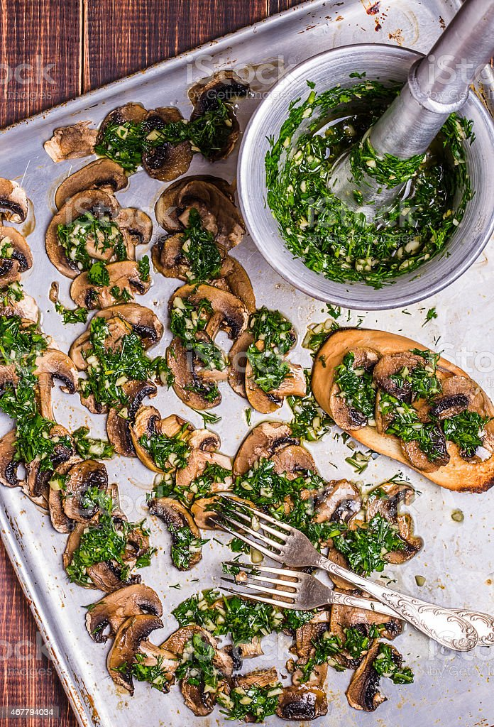 Baked mushrooms with chimichurri stock photo