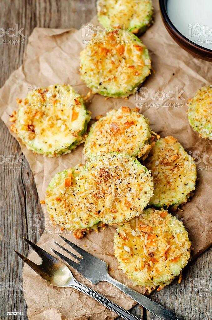 baked parmesan zucchini crisps stock photo