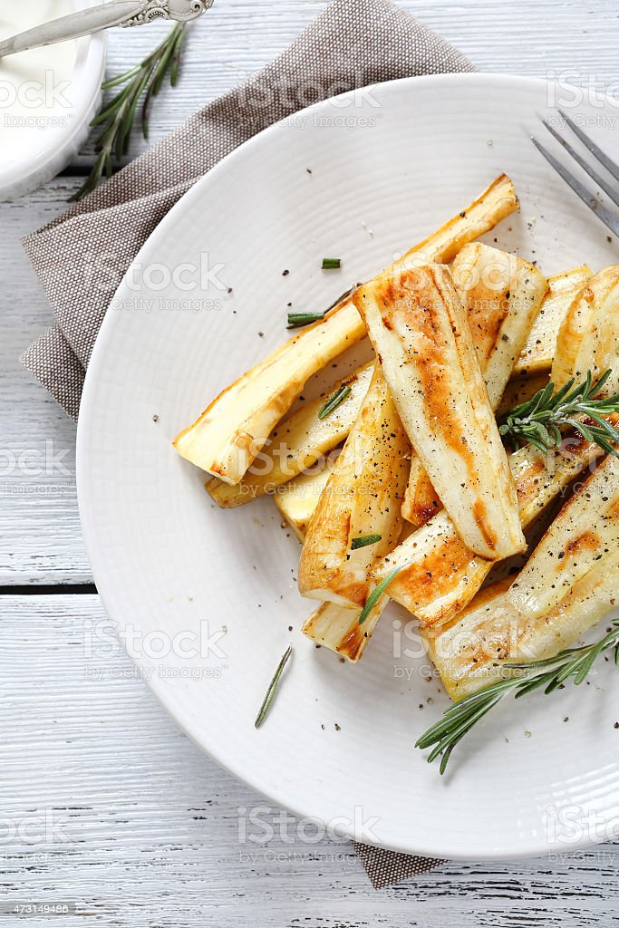 Baked parsnips on plate stock photo