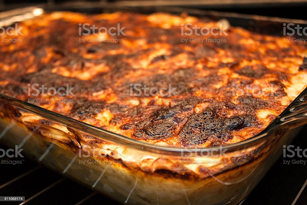 Baked pasta bake with melted cheese stock photo