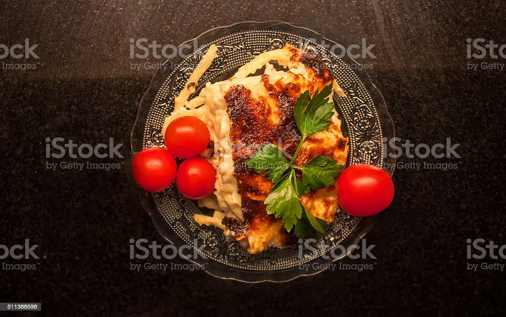 Baked pasta portion from top stock photo