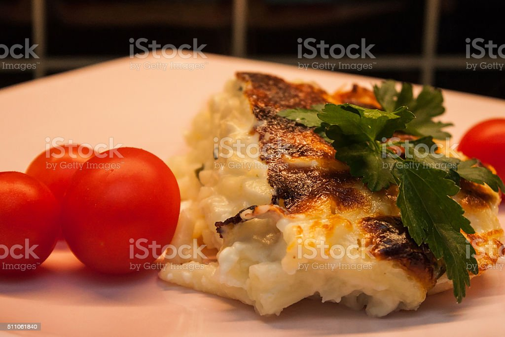 Baked pasta portion in pink plate macro stock photo