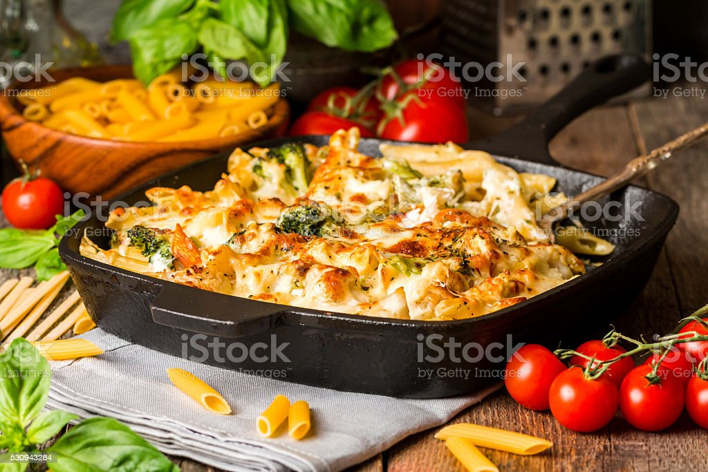 Baked pasta with broccoli, cauliflower, cheese and bechamel sauc stock photo