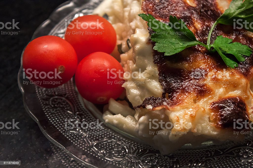 Baked pasta with tomatoes stock photo