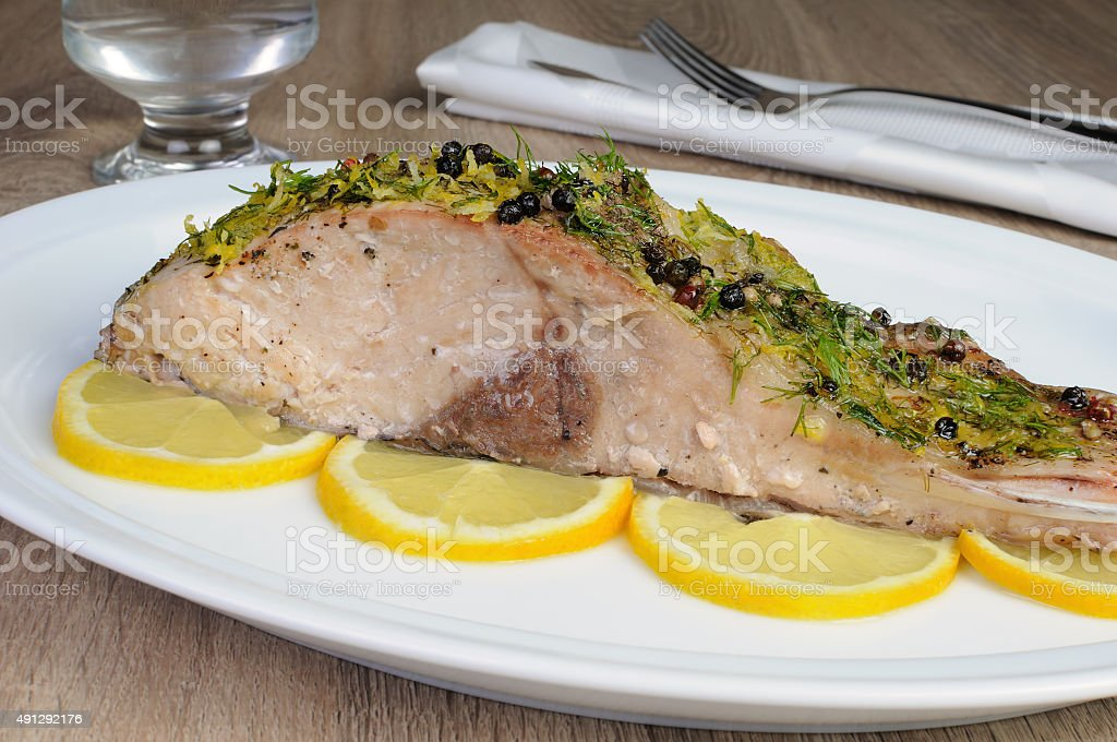 Baked piece of carp stock photo