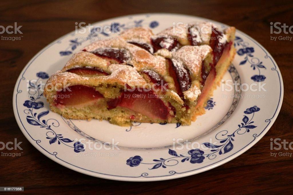 baked plum cake with powder sugar stock photo