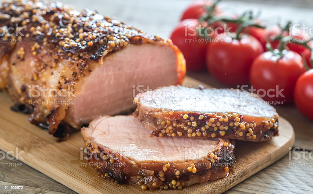 Baked pork meat wrapped in bacon stock photo