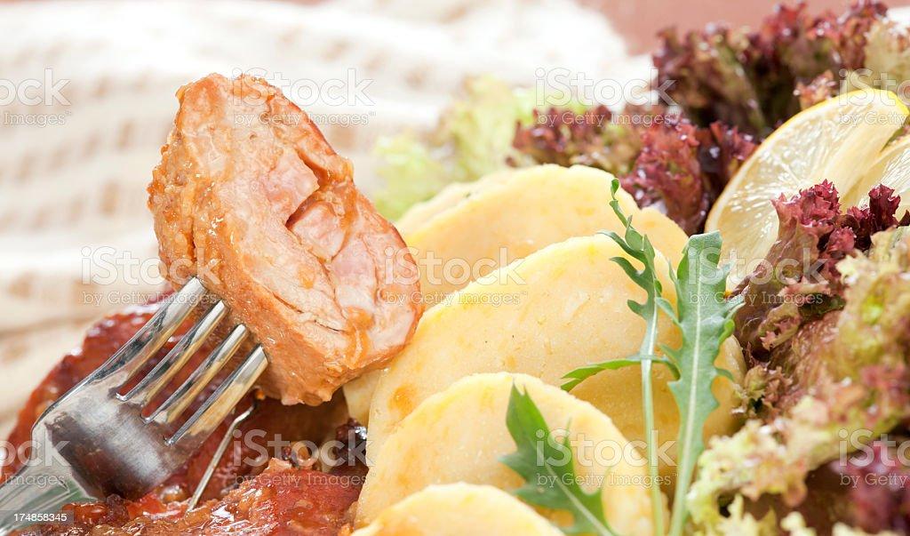 Baked pork roll with potato dumplings royalty-free stock photo