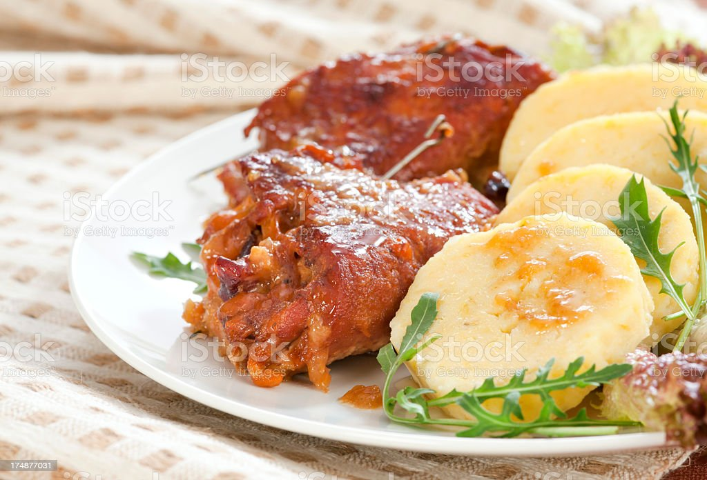 Baked pork roll with potato dumplings royalty-free stock photo