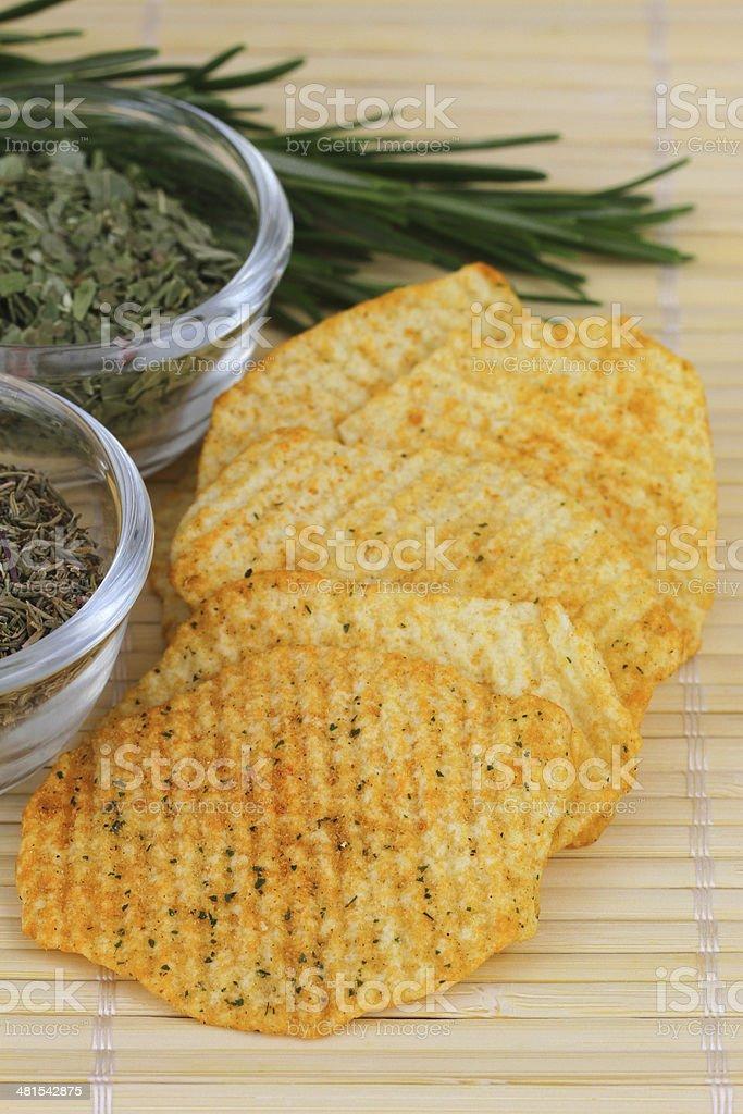 Baked potato crisps with Mediterranean herbs royalty-free stock photo