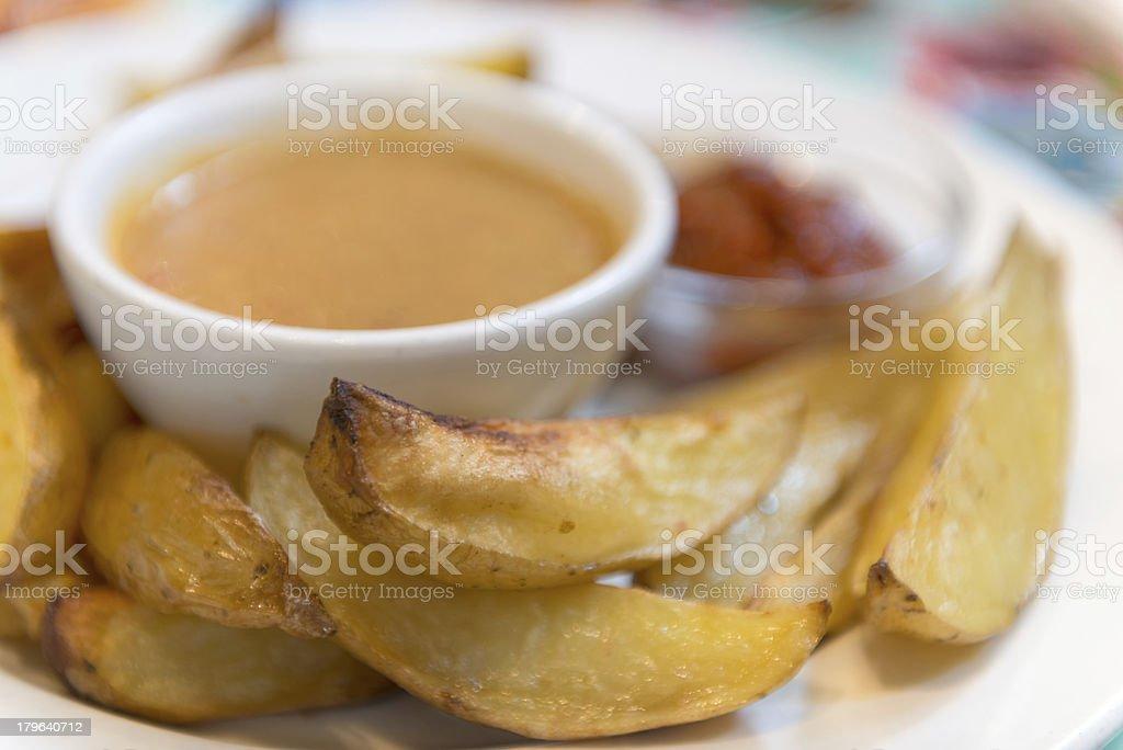 Baked Potato Wedges, Miso Gravy & Ketchup royalty-free stock photo