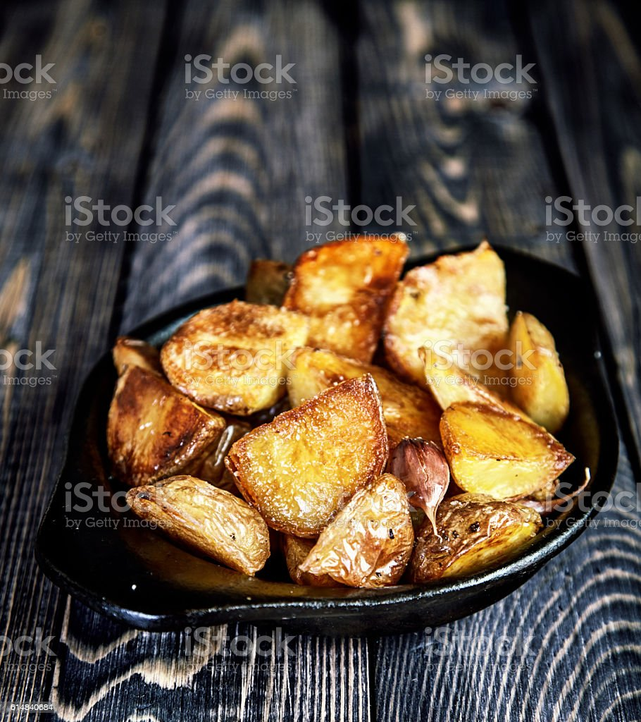 Baked potato wedges with garlic, christmas garnish stock photo