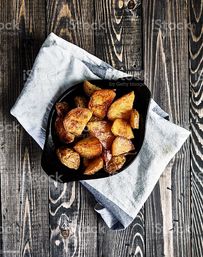 Baked potato wedges with garlic, christmas garnish stock photo