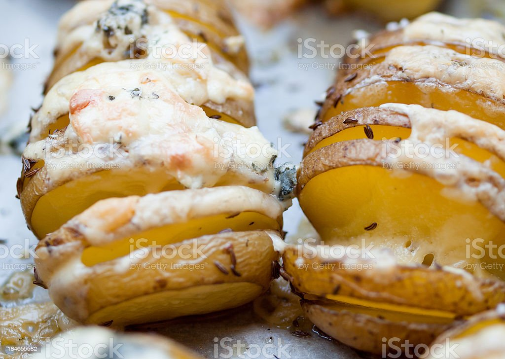 Baked potato with cheese stock photo