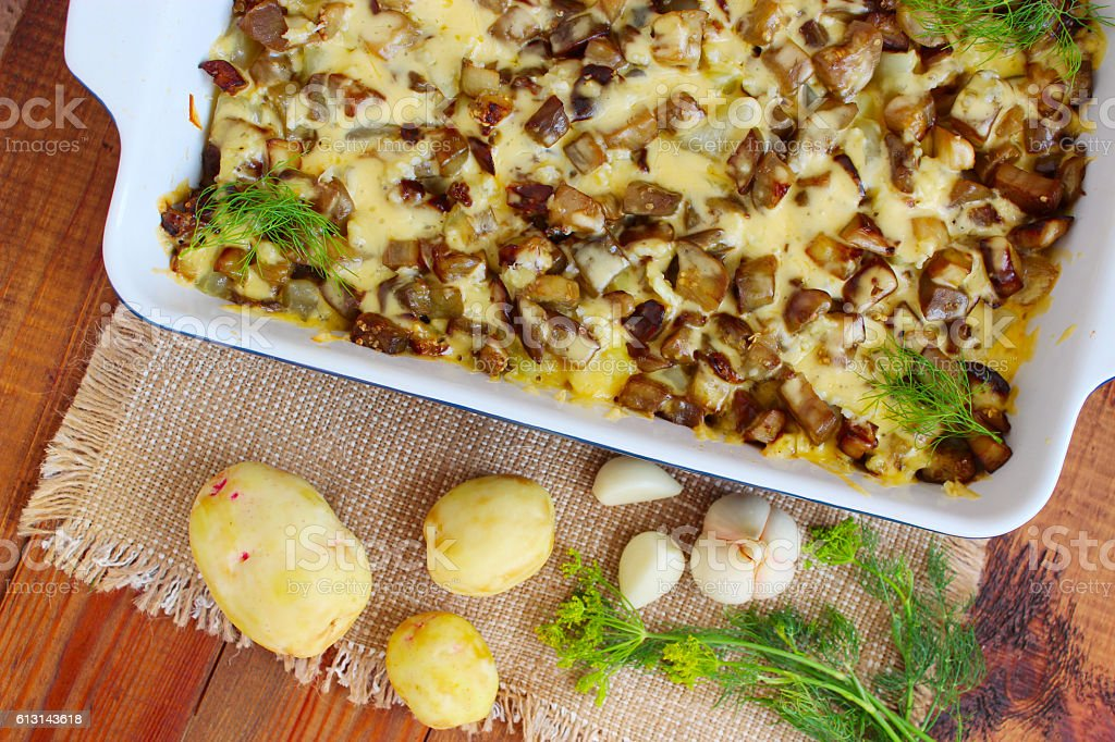 Baked potato with eggplant cheese and garlic stock photo