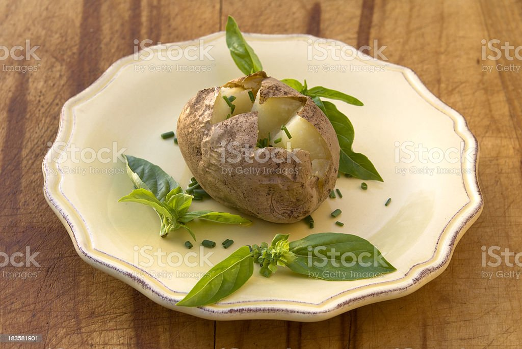 Baked Potato with Herb Butter, Chives & Fresh Basil, Healthy Meal stock photo