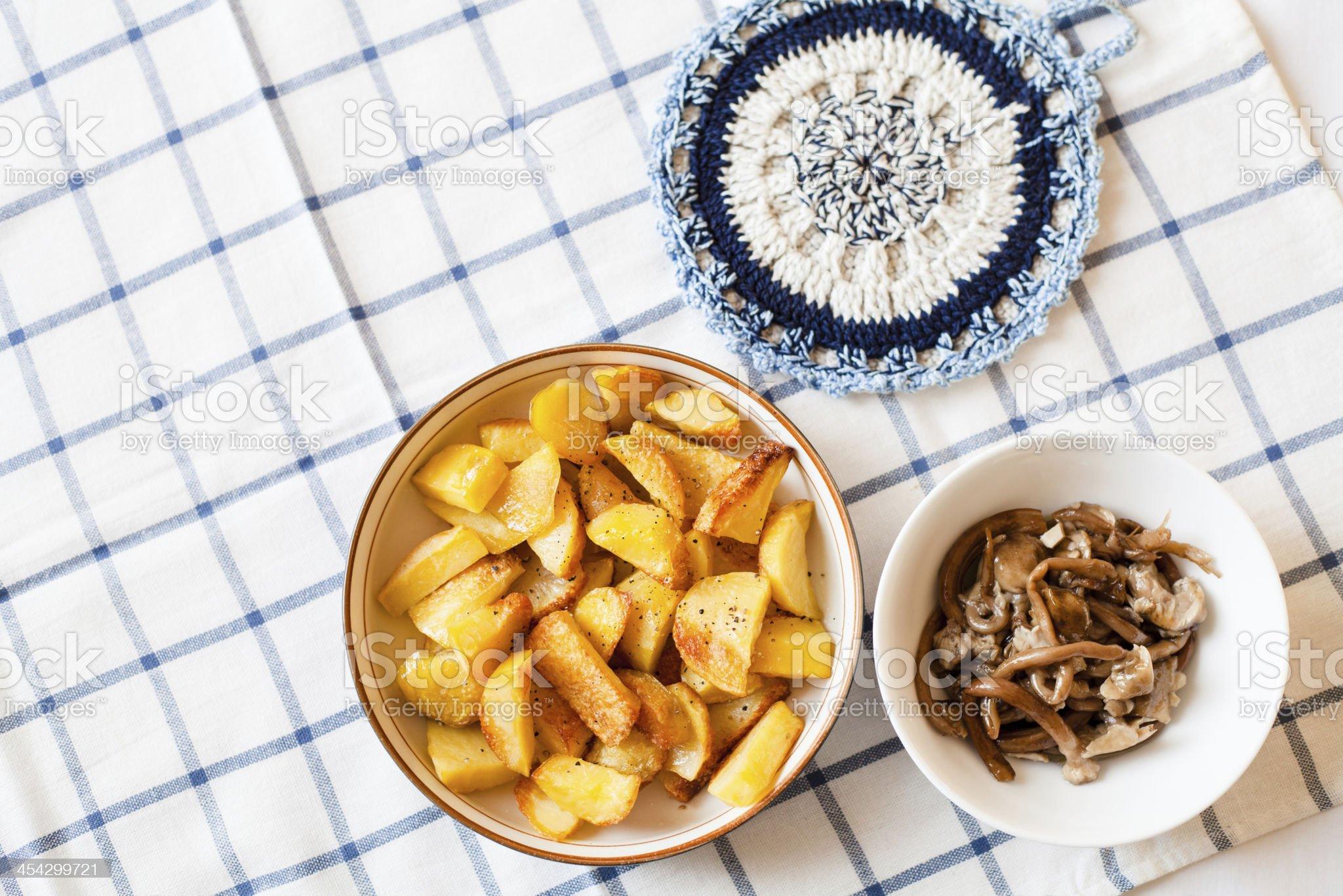 Baked Potatoes and Mushrooms royalty-free stock photo