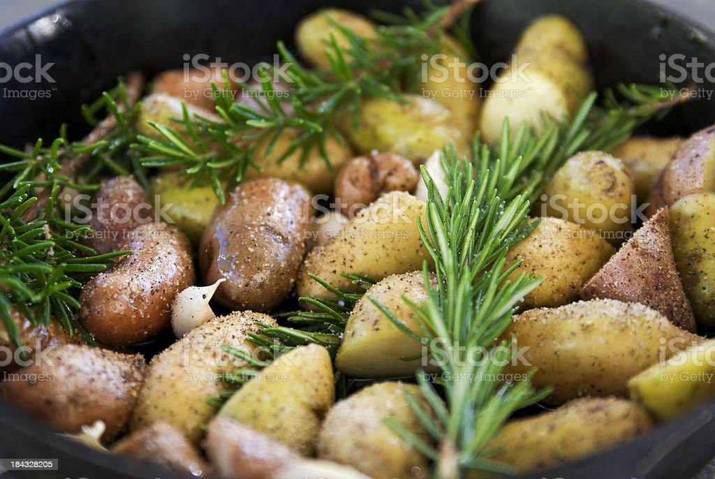 Baked Potatoes, Garlic & Rosemary stock photo