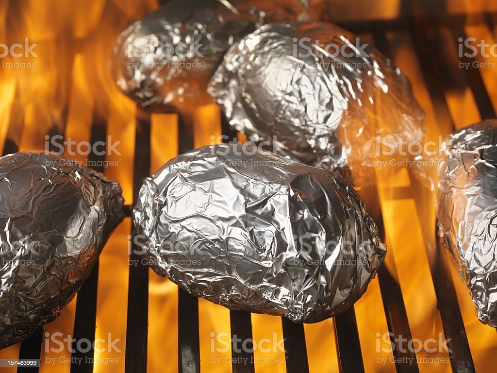 Baked Potatoes on the BBQ stock photo