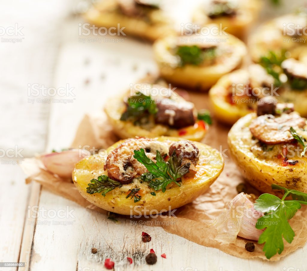 Baked potatoes stuffed with mushroom and cheese stock photo