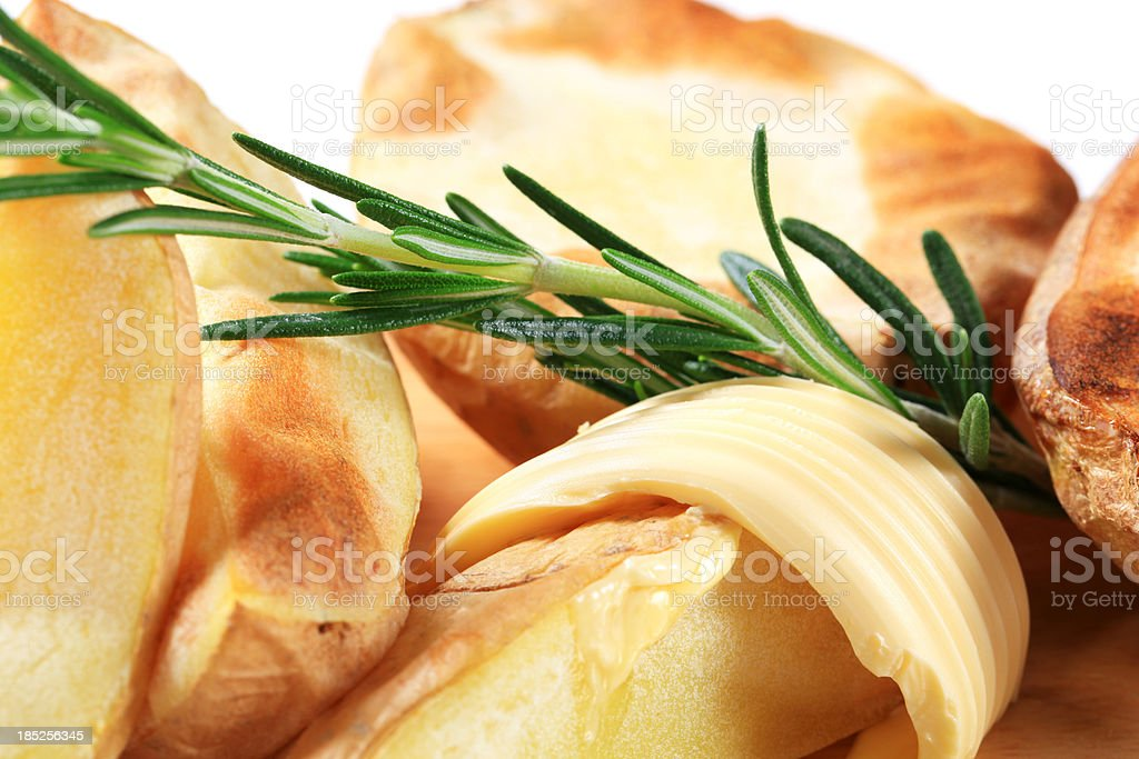 Baked potatoes with butter royalty-free stock photo