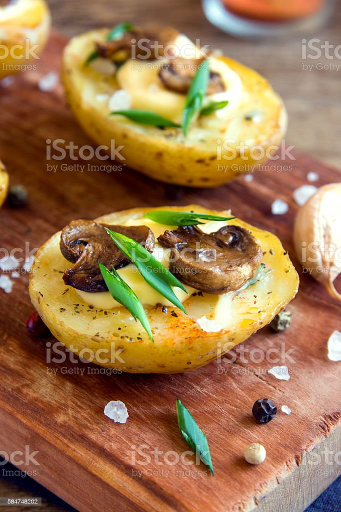 Baked potatoes with mushroom stock photo