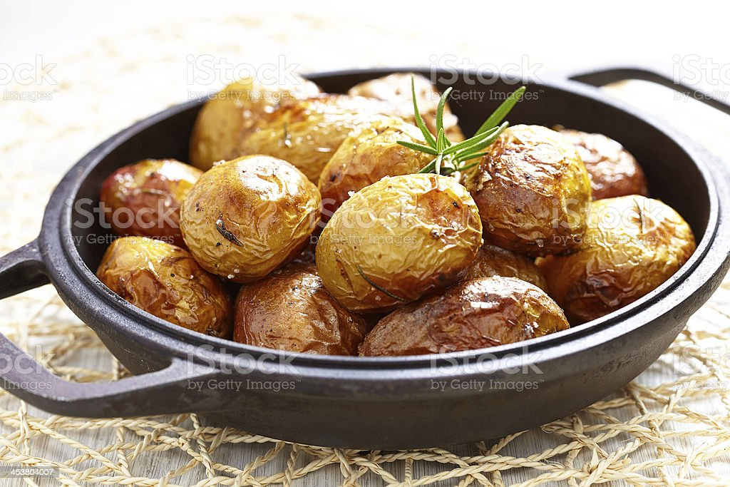 Baked potatoes with rosemary stock photo