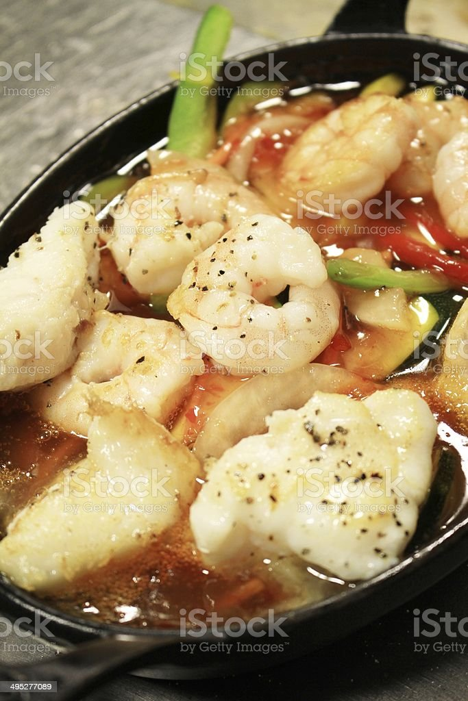 baked prawns and monkfish in skillet pan royalty-free stock photo