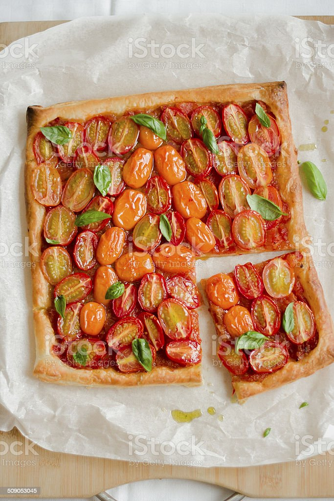 Baked puff pastry with cherry tomatoes stock photo