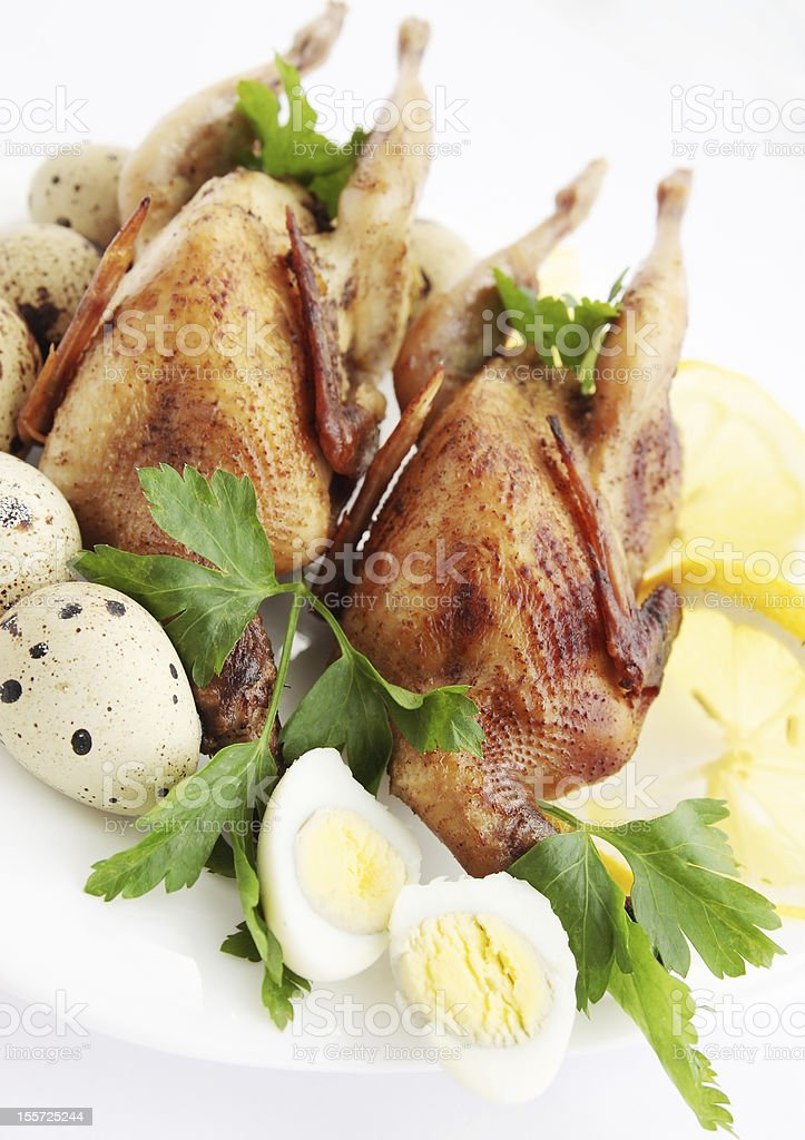 baked quail with greens royalty-free stock photo