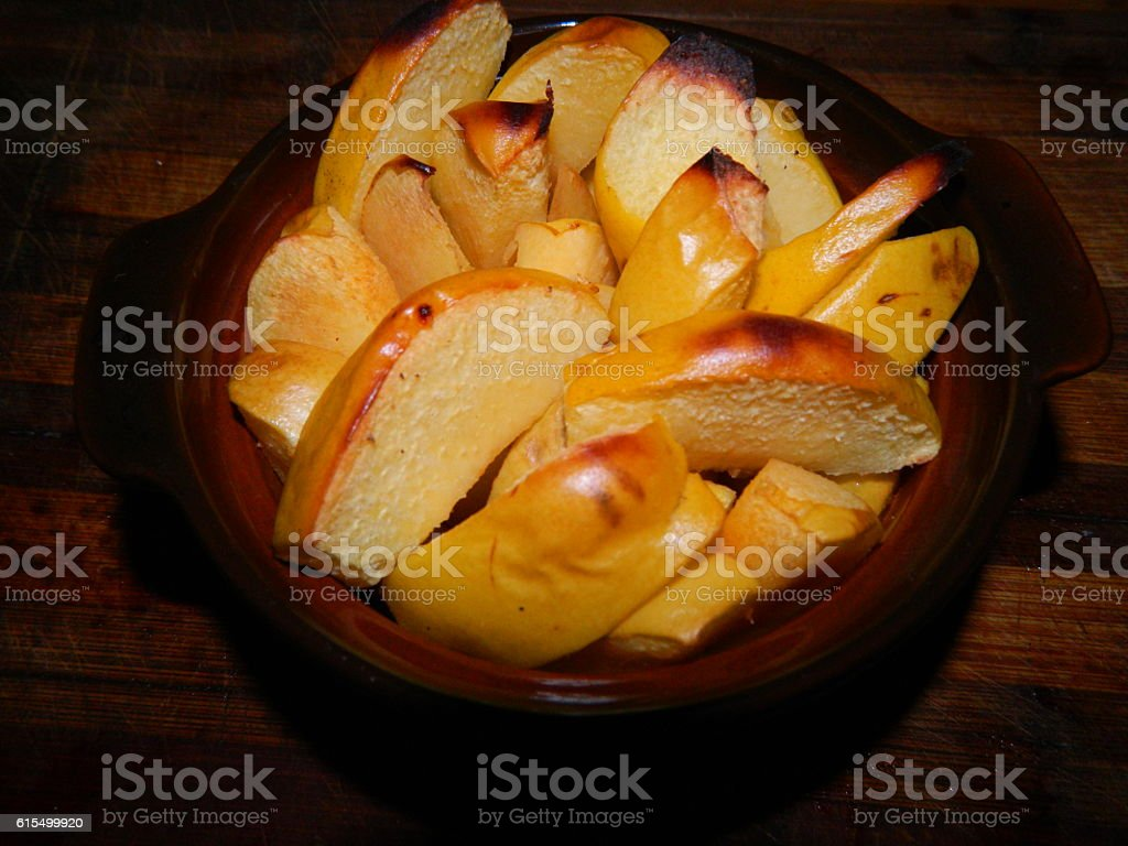 Baked quince slices vegetable yellow and rosy breakfast stock photo