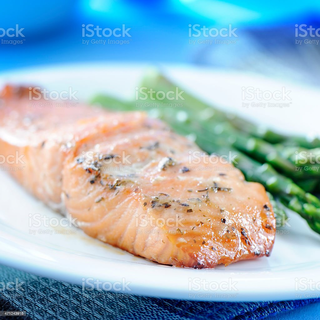 Baked salmon and asparagus on a white plate stock photo