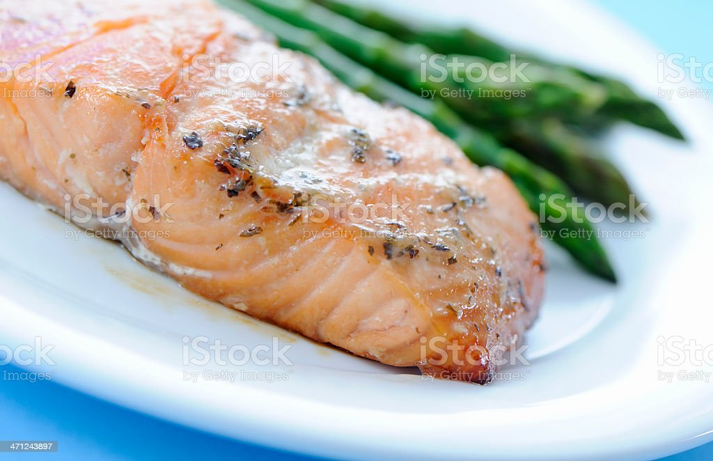 Baked salmon and asparagus served on a plate stock photo