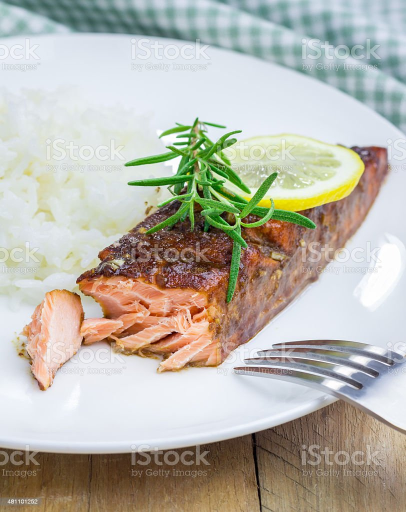 Baked salmon fillet in balsamic-honey sauce with rice stock photo