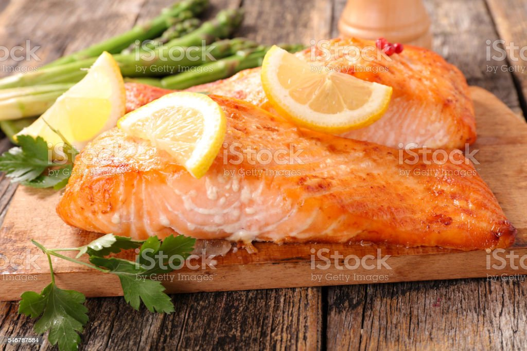 baked salmon fillet on board stock photo