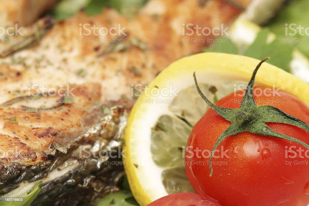 Baked salmon fillet with rucola - closeup royalty-free stock photo