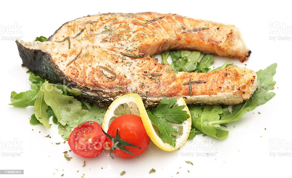 Baked salmon fillet with rucola royalty-free stock photo