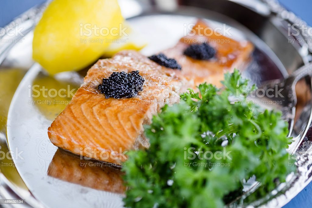Baked Salmon on a Silver Plate stock photo