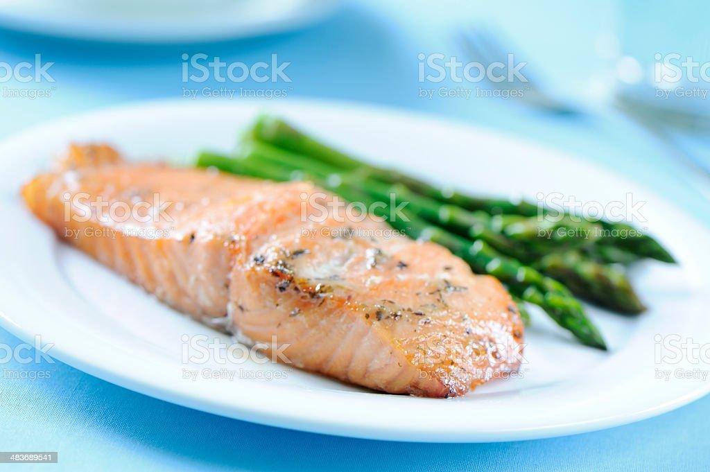 Baked salmon with asparagus stock photo