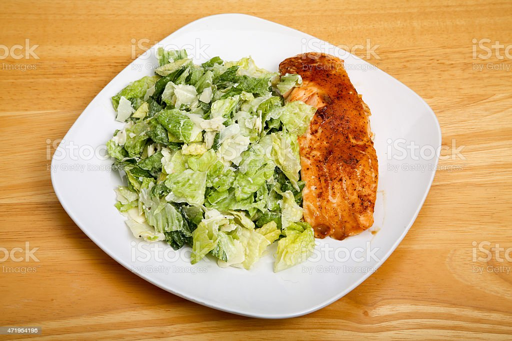 Baked Salmon with Ceasar Salad on Square Plate stock photo