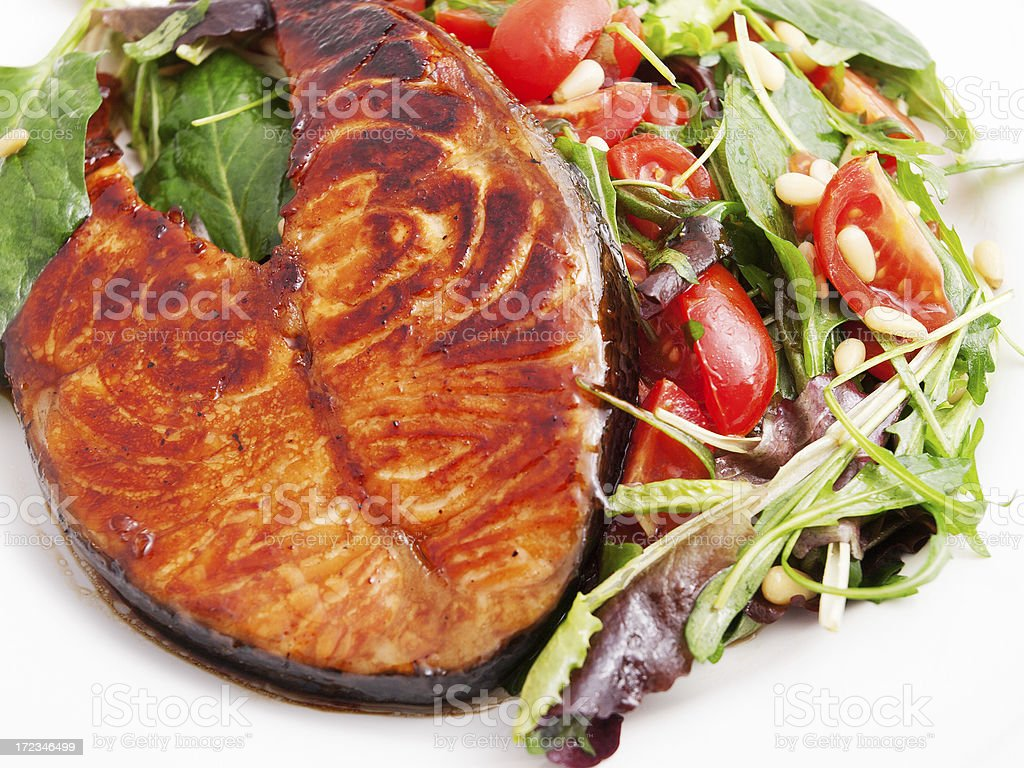 Baked salmon with fresh salad royalty-free stock photo