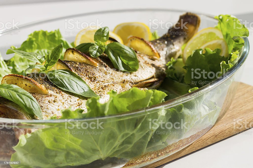 Baked Salmon with Lemon, Salad and Basil royalty-free stock photo