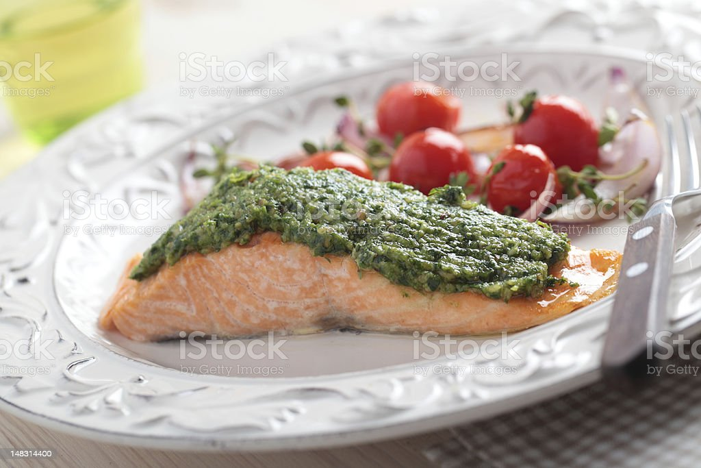 Baked salmon with pesto stock photo