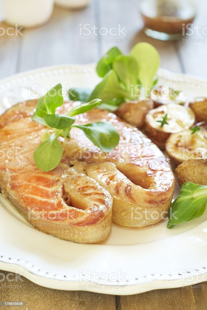 Baked salmon with potato and corn salad royalty-free stock photo