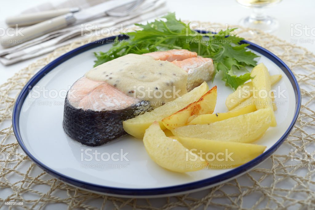 Baked salmon with vegetables stock photo