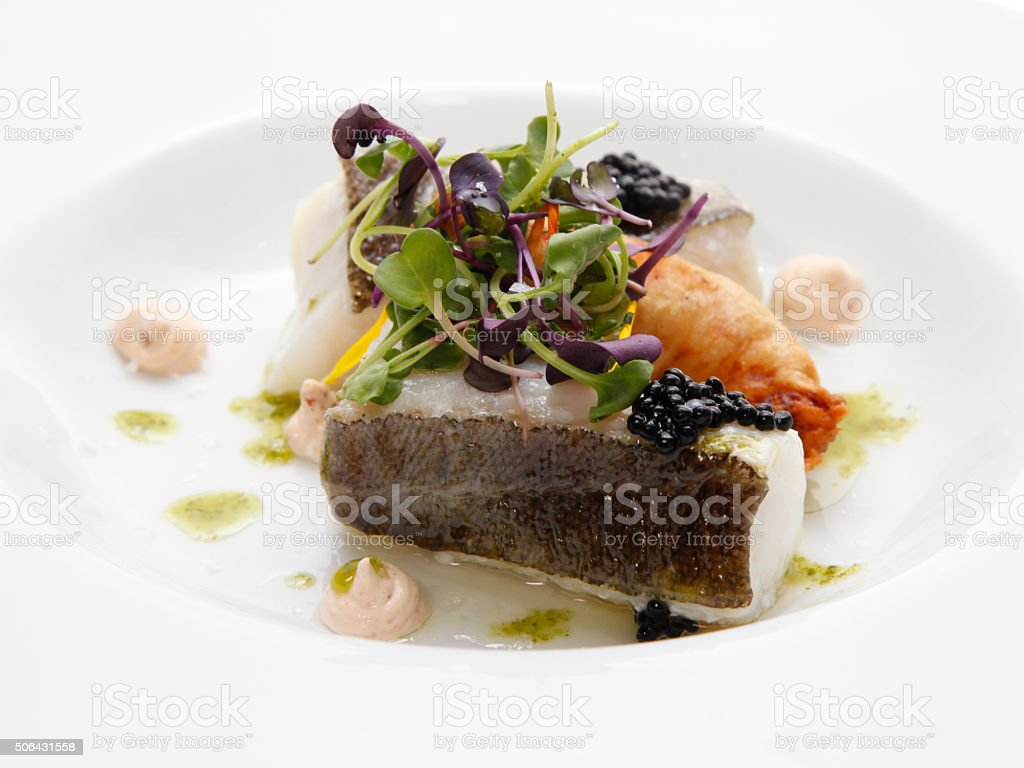 Baked sea bass with vegetables stock photo
