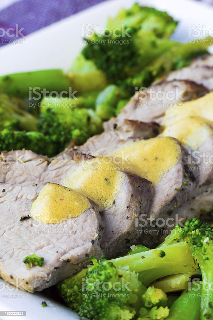 Baked, sliced fillet of pork with green vegetables, broccoli, haricot stock photo
