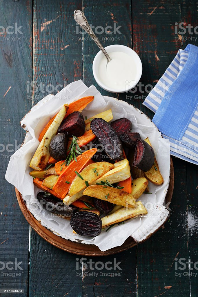 baked slices of spiced vegetables stock photo